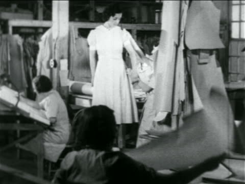 B/W 1934 women being fitted in dress in WPA garment factory / documentary