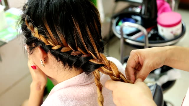 women braid hairstyle in beauty salon - braided hair stock videos and b-roll footage