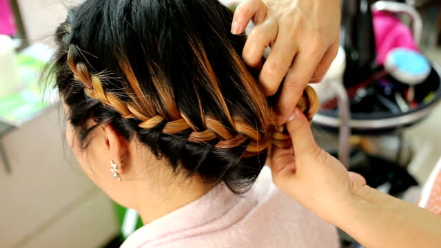 women braid hairstyle in beauty salon