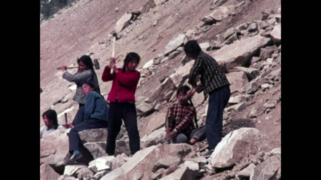 women break rocks on steep mountainside, china; 1973 - communism stock videos & royalty-free footage