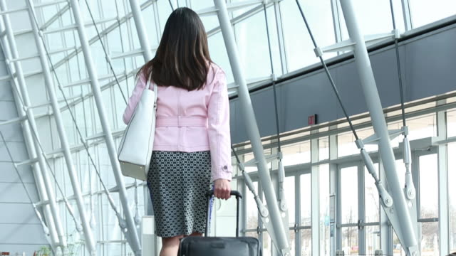 Women business traveller walking out of terminal