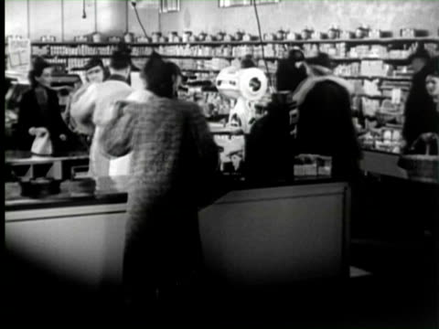 b/w montage women buying goods in grocery store, united states / audio - canned food stock videos & royalty-free footage