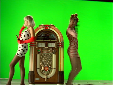 2 women by jukebox, 1 dancing / chroma key background - jukebox stock videos & royalty-free footage