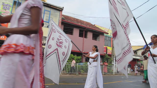ms pan women carrying standard bearers parade in seenigama annual perahern parade in buddhist procession audio / sinigama, southern province, sri lanka - sri lankan culture stock videos & royalty-free footage