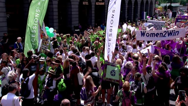 women celebrate 100 years since the suffragettes secured the vote for women; uk, london: women marching through london during suffrage parade to mark... - 100. jahrestag stock-videos und b-roll-filmmaterial