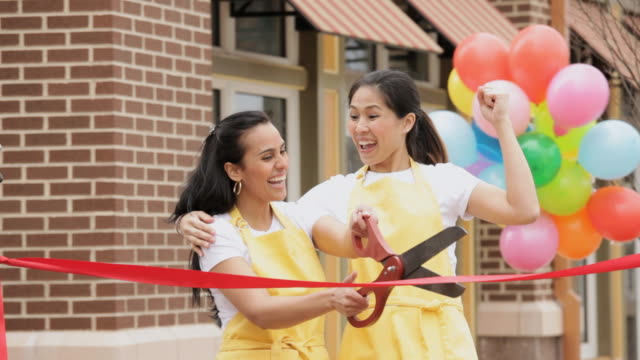 ms women celebrating new business with ribbon cutting / richmond, virginia,united states - schere stock-videos und b-roll-filmmaterial