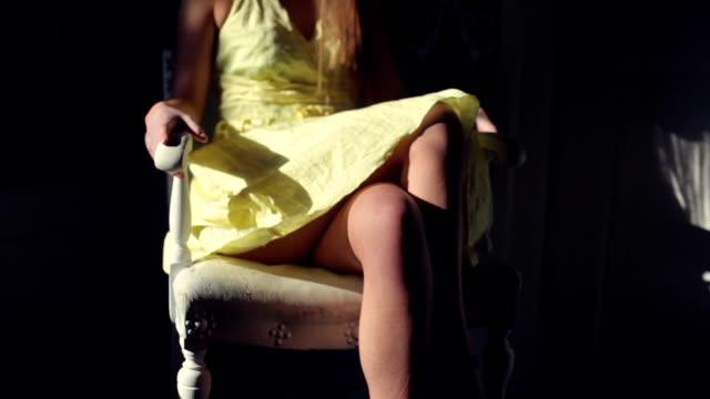 stockvideo's en b-roll-footage met women, chair, sexy legs. - dameskleding