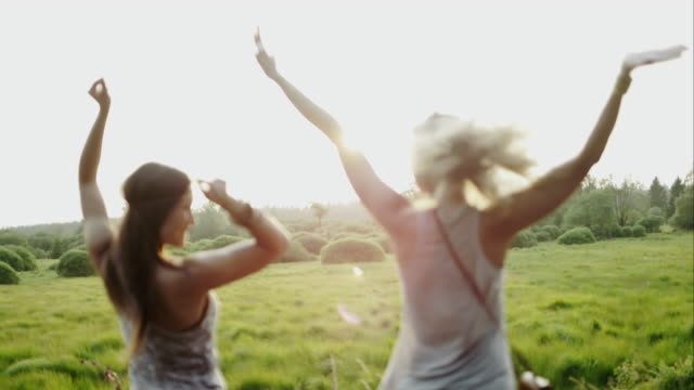 Women cheering outdoors on roadtrip