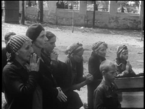 b/w 1939 women children praying in front of church / warsaw poland / documentary - 1939 stock videos & royalty-free footage