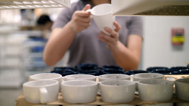 women choose a cup in the store , slow motion - ceramics stock videos & royalty-free footage