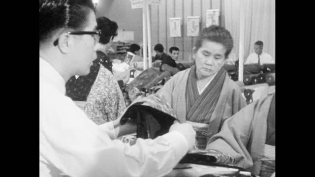 women choose kimono fabric in tokyo department store; 1964 - salesman stock videos & royalty-free footage