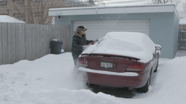 ws women cleaning snow off car - only mid adult women stock videos & royalty-free footage