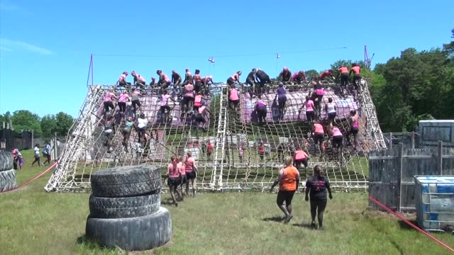 women climb over obstacle at adventure race - rivalry stock videos & royalty-free footage