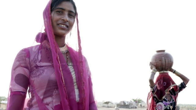women collecting clean water in rajasthani desert. - sari stock videos and b-roll footage