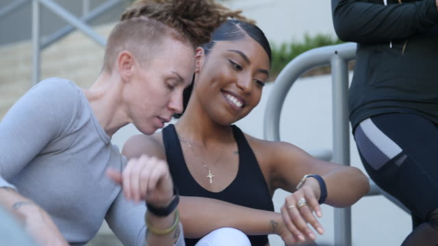 women comparing their fitness progress after workout - smart watch stock videos & royalty-free footage