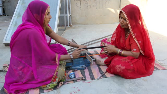 Women constructing solar cookers at the Barefoot College in Tilonia, Rajasthan, India.