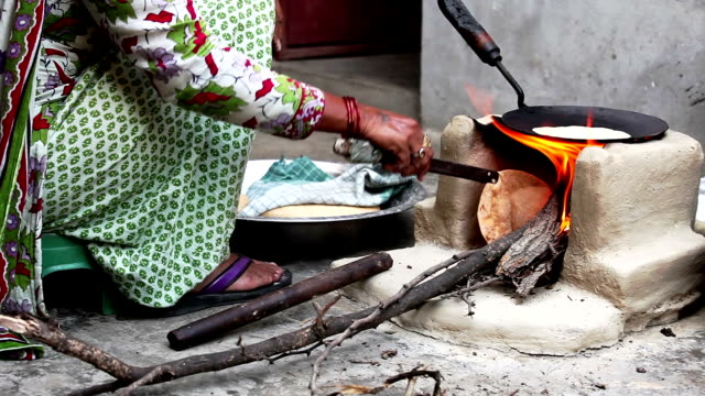 Women Cooking Food on Mud Stove at Home