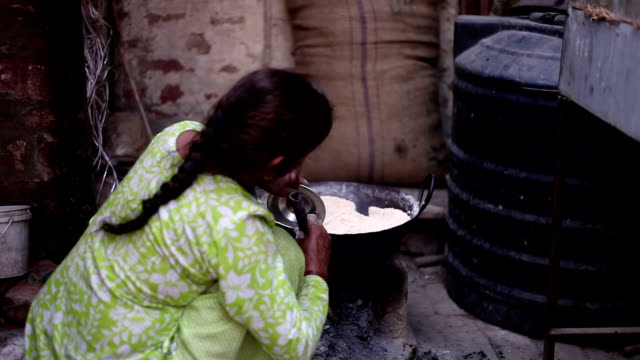 Women cooking food on mud stove