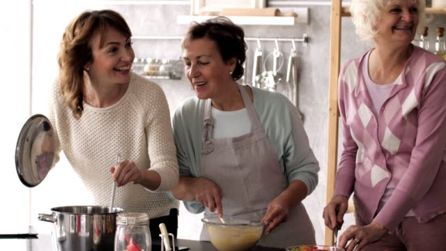 women cooking together in the kitchen - batter food stock videos & royalty-free footage