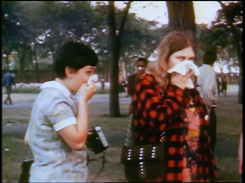 1968 2 women covering faces during teargassing at antiwar protest / Chicago / newsreel
