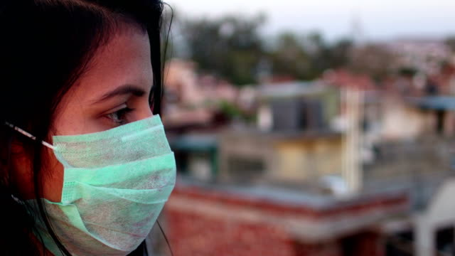 women covering her face with pollution mask for protection from viruses - india stock videos & royalty-free footage