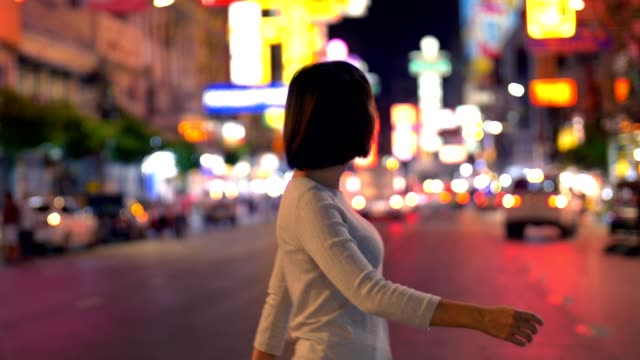 women crossing the road in bangkok chinatown at night - rhythm stock videos & royalty-free footage