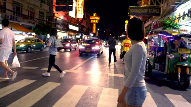 women crossing the road in bangkok chinatown at night - zebra crossing stock videos & royalty-free footage