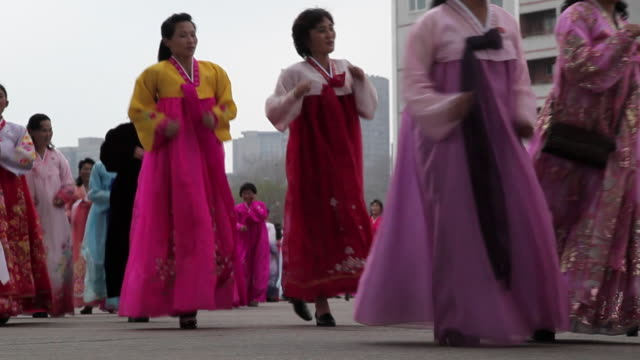 Women dance in the streets to celebrate the 100th Anniversary of the birth of President Kim Jong Il in Pyongyang, North Korea.