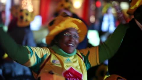 stockvideo's en b-roll-footage met ms zo swish pan zo women dancing at night with crowd / soweto, gauteng, south africa, audio - 2010
