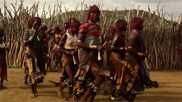 women dancing during whipping ritual in the Bull Jumping ceremony Hamar Tribe Omo river South Ethiopia