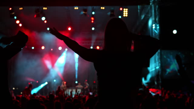 ds women dancing on men's shoulders at a night concert - shoulder ride woman stock videos & royalty-free footage