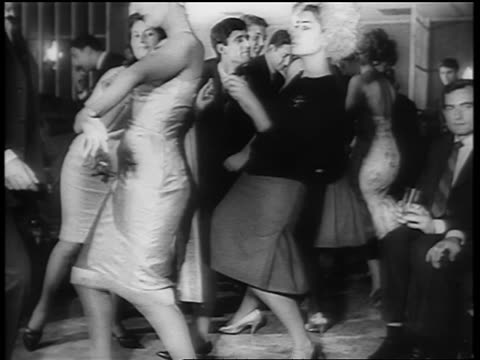 b/w 1961 women dancing the twist on dance floor / newsreel - klassischer rock and roll stock-videos und b-roll-filmmaterial