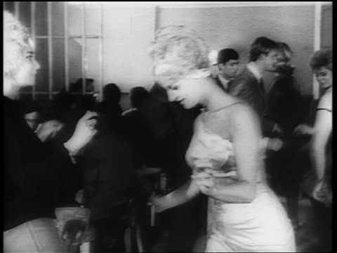 b/w 1961 2 women dancing the twist together on dance floor / newsreel - klassischer rock and roll stock-videos und b-roll-filmmaterial