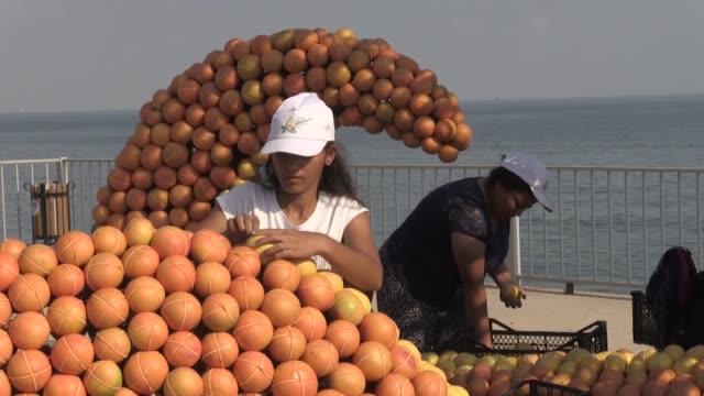 women decorate sculptures with orange lemon mandarin and grapefruit ahead of the 7th mersin international citrus festival on october 27 2019 in... - orange frucht stock-videos und b-roll-filmmaterial