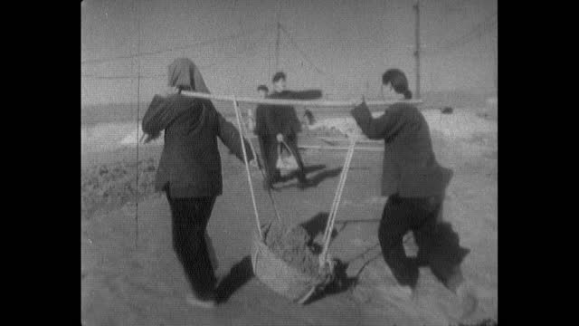 women dig and move earth by hand on building site; 1964 - maoism stock videos & royalty-free footage