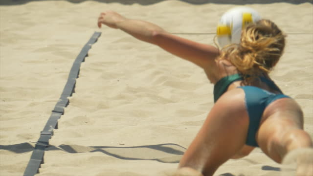 women digging and diving playing pro beach volleyball in the sand. - slow motion - game show stock videos & royalty-free footage