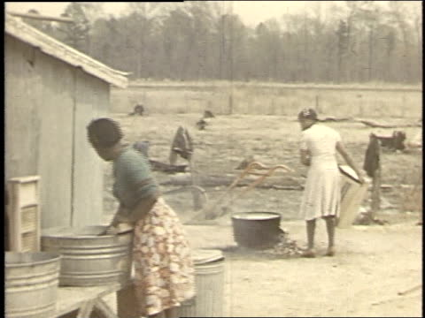 stockvideo's en b-roll-footage met 1940 montage women do laundry, draw water from pump / boligee, alabama, united states - alabama