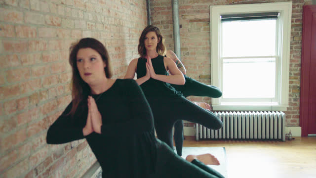 women do yoga exercises - barre stock videos and b-roll footage