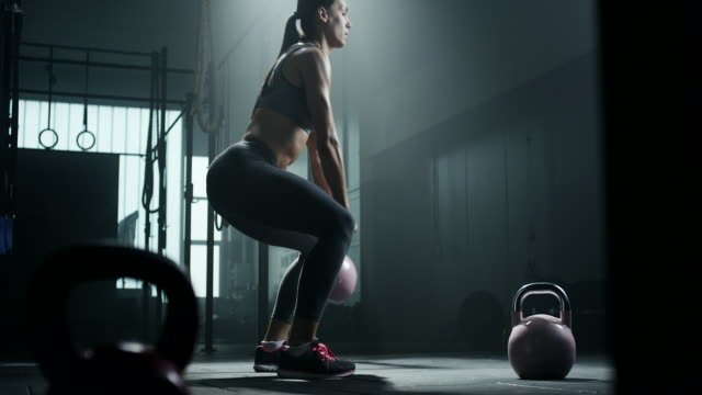 women doing exercise with kettlebell - sports training stock videos & royalty-free footage