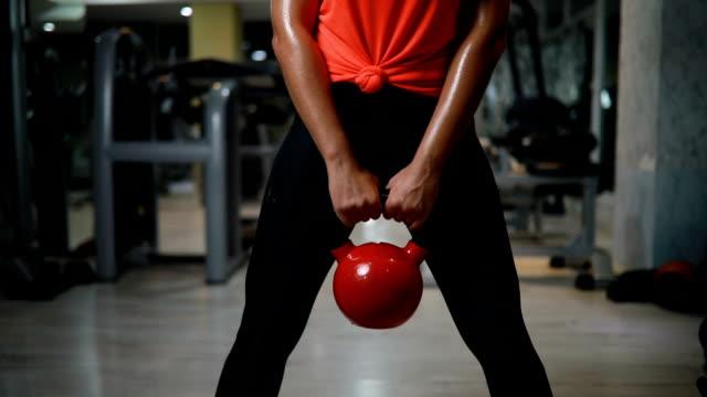 Women doing exercise with kettlebell