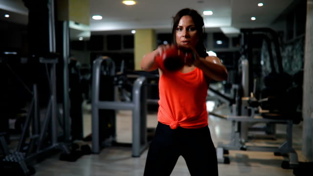 women doing exercise with kettlebell - cura della persona video stock e b–roll