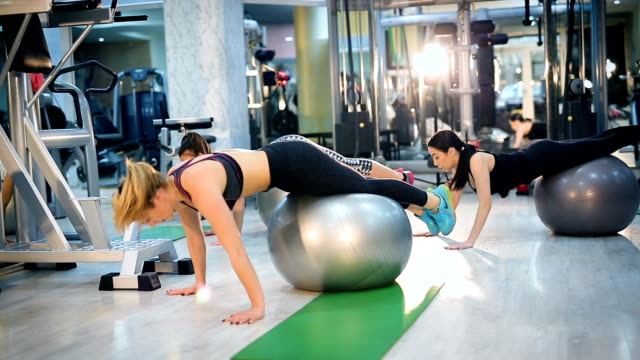 women doing exercises with fit ball in fitness gym - fitness ball stock videos & royalty-free footage