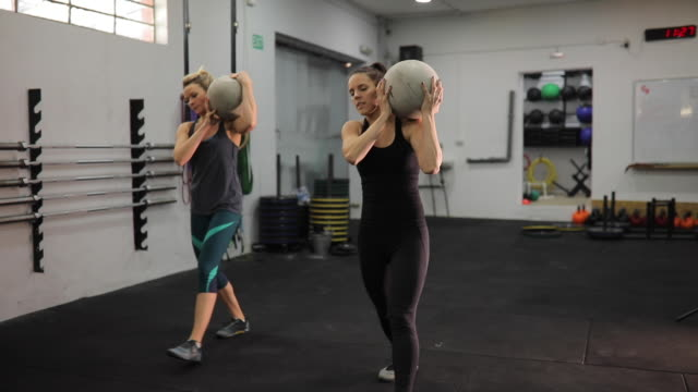 women doing lunges with ball - ball stock videos & royalty-free footage