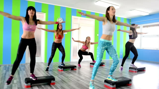 women doing step aerobics - step aerobics stock videos and b-roll footage