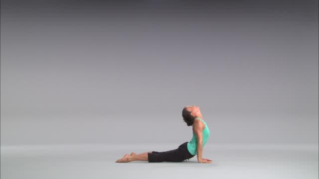ws women doing yoga on white stage / portland, oregon, usa - ヨガ点の映像素材/bロール