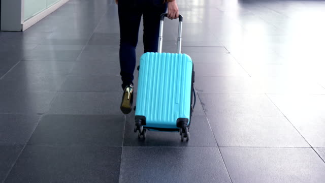 women dragging luggage in the airport - rucksack stock videos & royalty-free footage