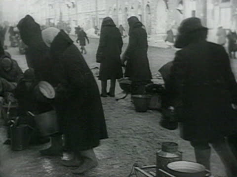 women drawing water and washing linen on street, dead and sick people standing cold weather and falling down audio / leningrad, russia - st. petersburg russia stock videos & royalty-free footage