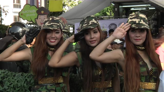 Women dressed in army fatigues pose for photos during the reconciliation effort to bring unity to the divided societies together by the Army and...