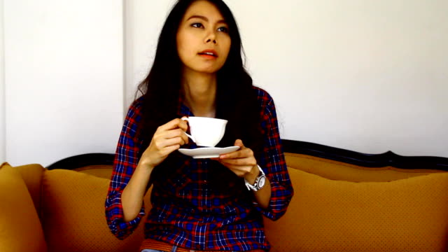 women drink coffee on sofa - coffee drink stock videos & royalty-free footage