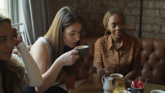 women drinking coffee - tilt up stock videos & royalty-free footage
